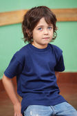 Cute Little Boy Sitting In Classroom — Стоковое фото