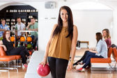 Beautiful Woman With Bowling Ball in Club — Stock Photo