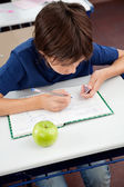 Schoolboy Copying From Cheat Sheet During Examination — Stock Photo