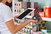Woman Scanning Barcode Through Digital Tablet — Stock Photo