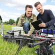 Technicians Discussing Over Digital Tablet By UAV — Stock Photo