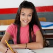 Teenage Schoolgirl Writing In Book — Stock Photo #33253045