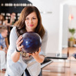 Young Woman Ready With Bowling Ball in Club — Stock Photo