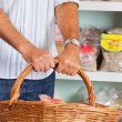 Stock Photo: Midsection Of MHolding Wicker Basket