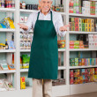 Senior Male Store Owner Welcoming In Supermarket — Stock Photo