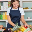 Stock Photo: WomWorking At Grocery Store