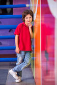 Boy With Hand On Chin Leaning On Wall — Stock Photo