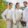 Stock Photo: Beekeepers Standing At Apiary