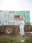 Beekeeper Standing Against Truck Loaded With Honeycomb Crates — Stock Photo