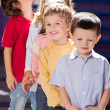 Stock Photo: Boy Standing With Friends In A Row At Kindergarten