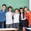 Teenage Friends Standing Together Against Board — Stock Photo