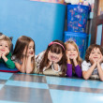 Boys And Girls Lying On Floor In Kindergarten — Stock Photo