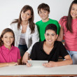Stock Photo: Portrait Of Teenage Students Using Tablet At Desk