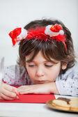 Boy Wearing Santa Headband Writing Letter To Santa Claus — Stock Photo