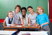 Teacher With Schoolchildren At Desk In Classroom — Stock Photo
