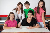 Portrait Of Teenage Students Using Tablet At Desk — Stockfoto
