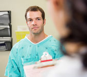 Patient Looking At Doctor In Hospital — Stock Photo
