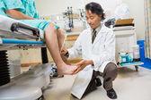 Neurologist Examining Patient's Reflexes — Stock Photo
