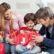 Boy And Parents Opening Christmas Present — Stock Photo