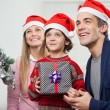 Parents With Boy Holding Christmas Present — Stock Photo