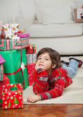 Boy Lying Besides Stacked Presents — Foto de Stock