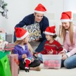 Family With Christmas Gifts And Decorations — Stock Photo #33530025