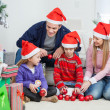 Family With Christmas Decorations And Gifts — Stock Photo