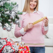 Smiling Woman With Christmas Gifts — Stock Photo