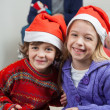 Happy Siblings Wearing Santa Hats At Home — ストック写真