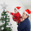 Boy And Father Decorating Christmas Tree — Stock Photo