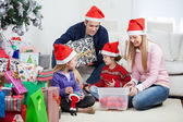 Family With Christmas Gifts And Decorations — Stock Photo