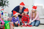 Family With Christmas Decorations And Gifts — Zdjęcie stockowe