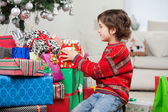 Boy Stacking Christmas Presents — Stock Photo