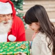 Girl Taking Christmas Gift From Santa Claus — Stock Photo