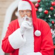 Santa Claus Gesturing Finger On Lips — Stock Photo
