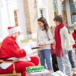 Stock Photo: Children Taking Biscuits From Santa Claus