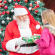 Santa Claus Giving Present To Girl — Stock Photo