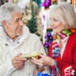 Couple Holding Christmas Gift At Store — Stock Photo