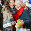 Affectionate Mother And Daughter With Christmas Presents — Stock Photo