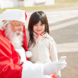 Girl With Santa Claus Using Smartphone — Stock Photo