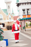 Santa Claus Carrying Bag While Walking In Courtyard — Stock Photo
