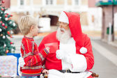 Boy Giving Wish List To Santa Claus — Stock Photo
