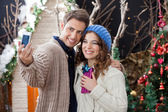 Couple Taking Selfportrait In Christmas Store — Stock Photo