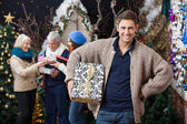 Happy Family With Presents In Christmas Store — Stock Photo