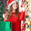 Woman Buying Christmas Ornaments In Store — Foto Stock