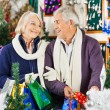 Happy Senior Couple Shopping In Christmas Store — Stock Photo #33730323