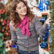 Stock Photo: Woman Shopping For Christmas Ornaments