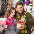 Man With Woman Shopping Presents In Christmas Store — Stock Photo #33730559