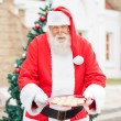 Santa Claus Offering Cookies — Stock Photo