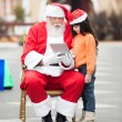 Santa Claus And Girl Using Digital Tablet — Stock Photo
